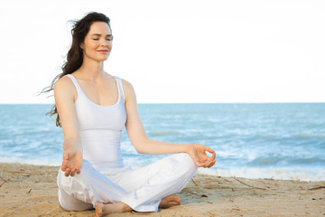 Beautiful young woman meditating