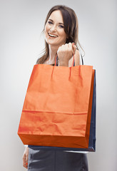 Smiling Woman hold shopping bag. Isolated portrait of young wom