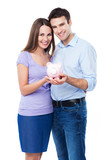 Young couple holding piggy bank