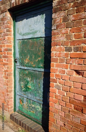 old door in brick wall