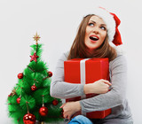 Christmas santa woman with christmas gift. Isolated smiling wom