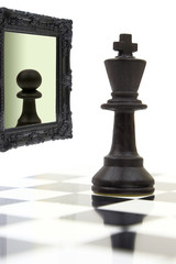 King looking in the mirror and seeing a pawn.