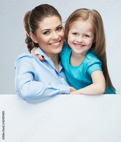 Mother and daughter embrace. Business woman with kid girl. Iso