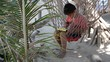 thai child on hammock using tablet