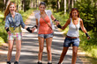 Cheerful young women on roller skates outdoor
