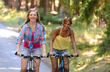 Two teenage girls riding their bikes