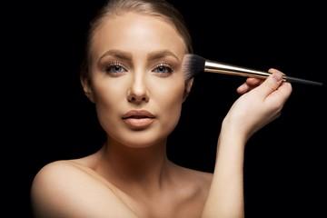 Beauty model applying makeup