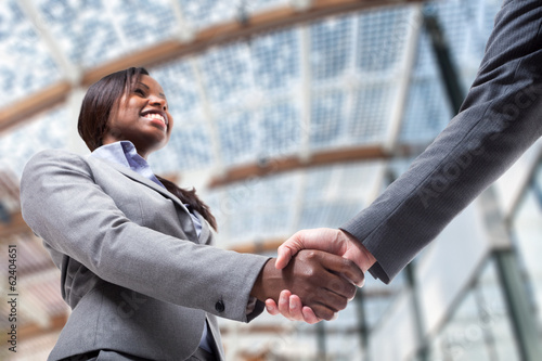 Business woman shaking her hand
