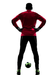 caucasian soccer player goalkeeper man rear view silhouette