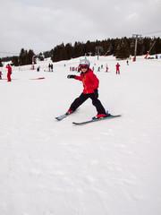 small girl skiing