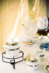 Retro tea set with bamboo background.