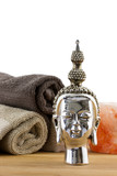 buddha figure with towels on the background