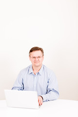 Middleaged man posing with laptop
