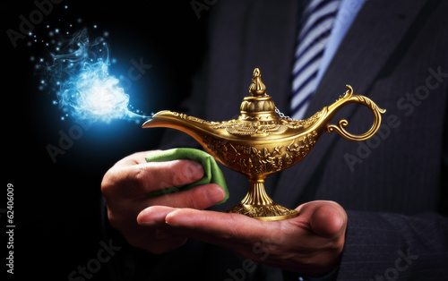 Rubbing magic Aladdins genie lamp