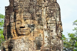 Stone head of Buddha on towers of Bayon temple in Angkor Thom