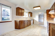 White kitchen room with brown storage combination and white appl