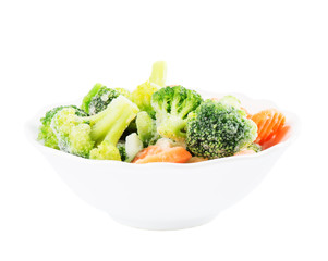 Frozen vegetables in ceramic bowl isolated on white