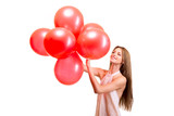 Beautiful smiling woman with red balloons on white background
