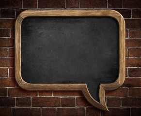 speech bubble blackboard on brick wall background