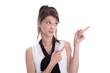 Junge schöne Frau zeigt etwas - skeptisch mit dem Zeigefinger