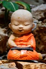 Little buddha sculpture in a temple