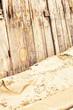 Wooden fence on sandy beach