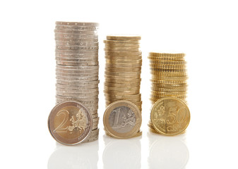 Piles of Euro money coins over white background