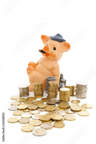 Funny piggy bank and piles of coins over white background