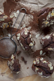 chocolate plum cake with cacao powder and almond flakes