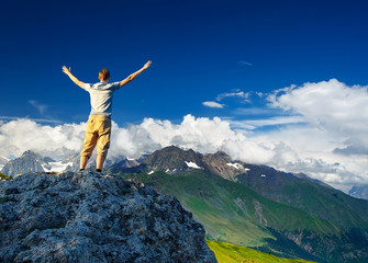 Tourist on mountain peak. Sport and active life