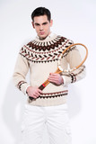 Retro tennis fashion man holding a vintage wooden racket. Studio