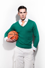 Retro basketball fashion man wearing a green sweater orange tie