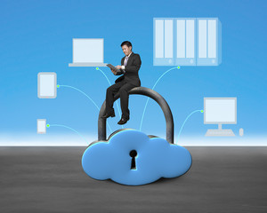 Man sitting on cloud shape lock with device