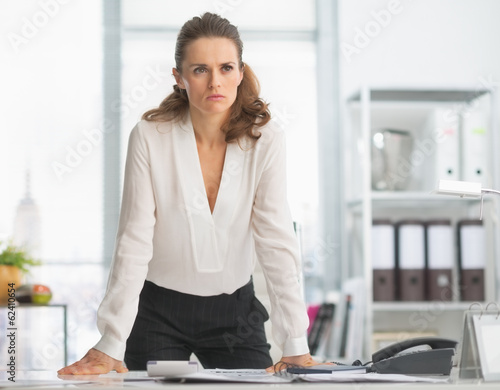Concerned modern business woman in office