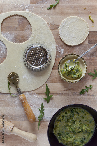 vegetarian tartellettes and cooking utensils on pastry board
