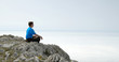 Man Sitting in the Lotus Position on the Rock Above the Sea
