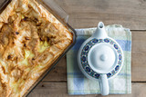 Oven dish with plain Turkish borek and a teapot