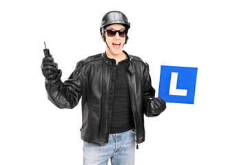Biker holding an l sign and a key