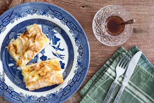 Slices of fresh Turkish borek served with tea
