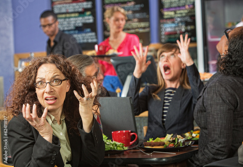 Surprised Executives in Cafe