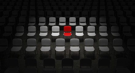 Grid of Chairs with a red Chair standing out