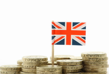 British Flag and pound coins on a white background