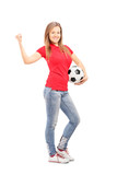 Full length portrait of a pretty girl holding a football