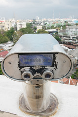 Public binocular service for sightseeing around temple.