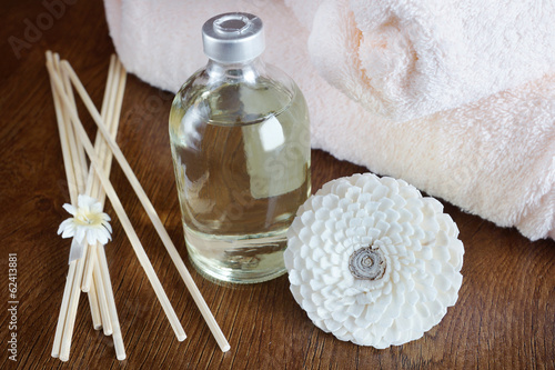 Sandal oil in a bottle and sticks for aromatherapy