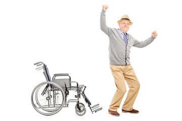 Overjoyed senior adult standing up from a wheelchair