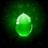 Glossy Easter egg on green background