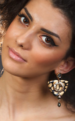Portrait of a beautiful woman with her earrings
