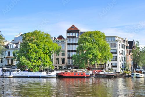 Foto op Canvas Amsterdam Amsterdam. River Amstel embankment