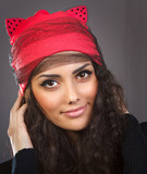 Portrait beautiful woman in a red hat